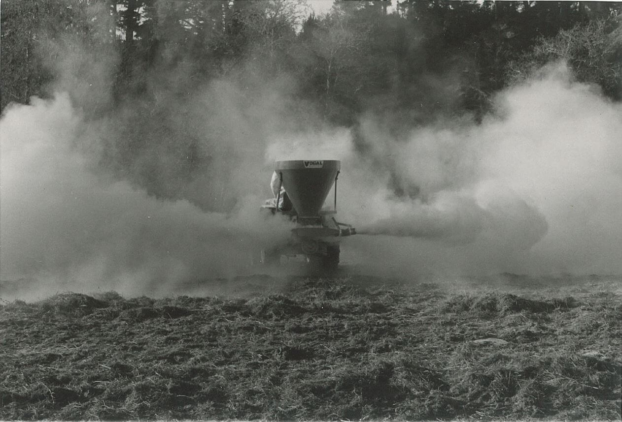 Vogal airblast spreader at work spreading lime or gypsum