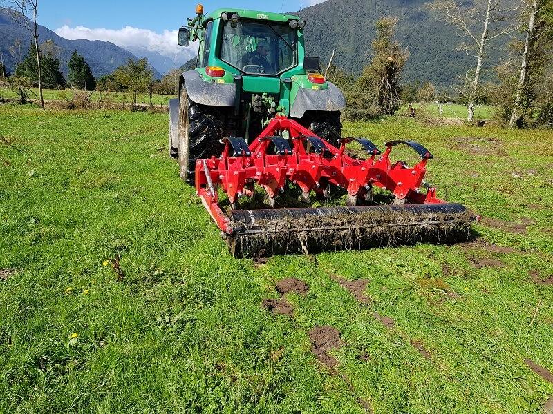 Rata Auto Reset Panerazer soil aerator behind John Deere Tractor
