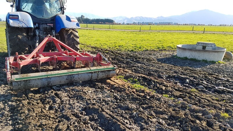 Subsoil Aerating compacted ground around a water trough.