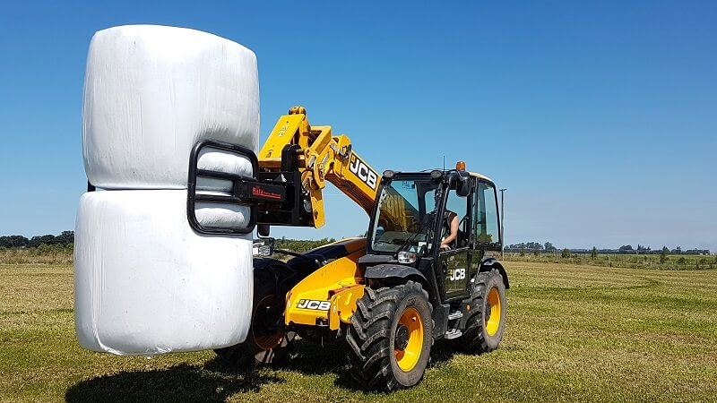 Rata Bale Clamp Softhands lifting two wrapped bales at a time on JCB Telehandler