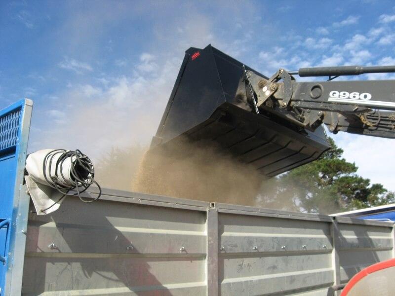 Rata bucket on tractor front end loader handling grain