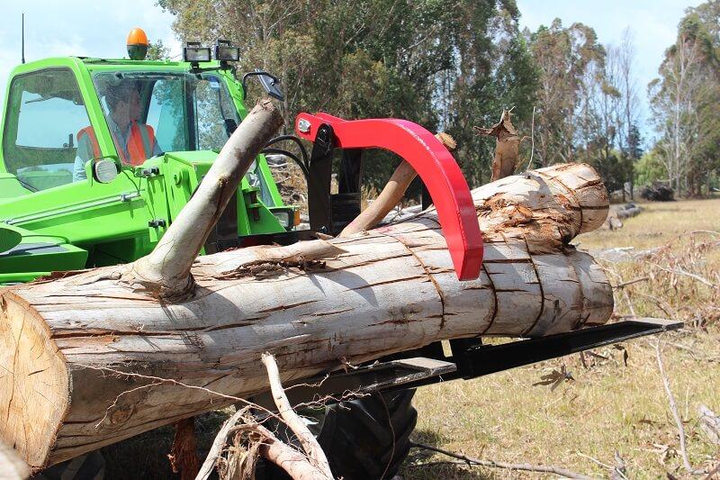 Log fork picking up an old tree on Merlo Telehandler