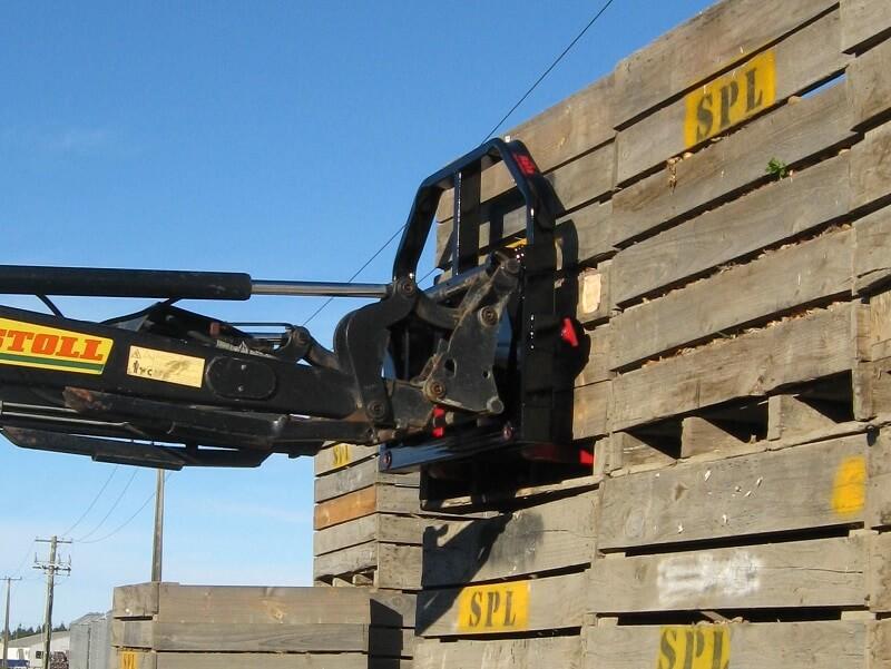Combo fork on front end loader handling pallet crates