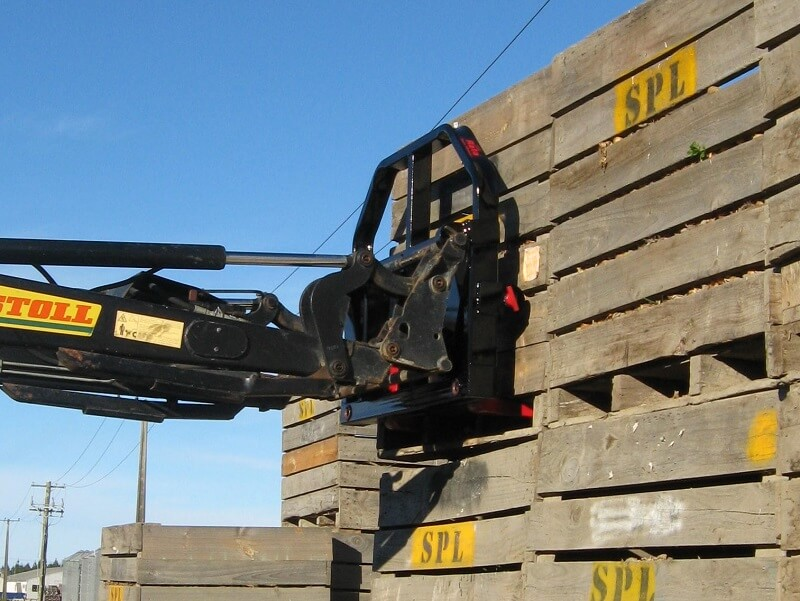 Combo fork on front end loader handling pallet crates