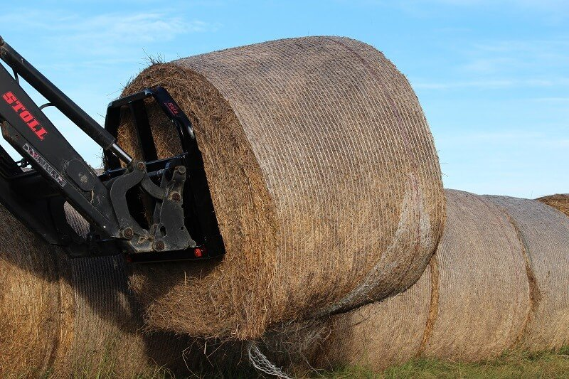 Combo fork handling round bales