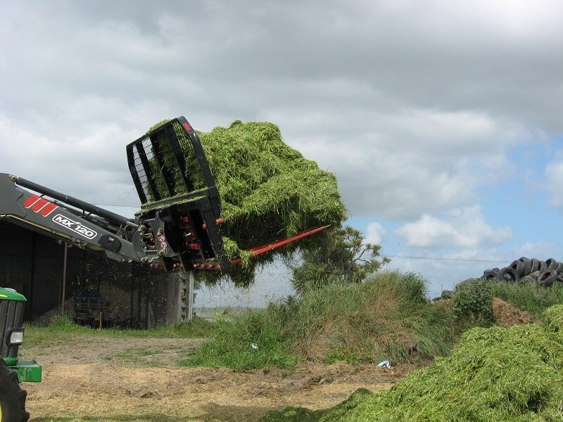 Push Off Buck Rake with a load of silage