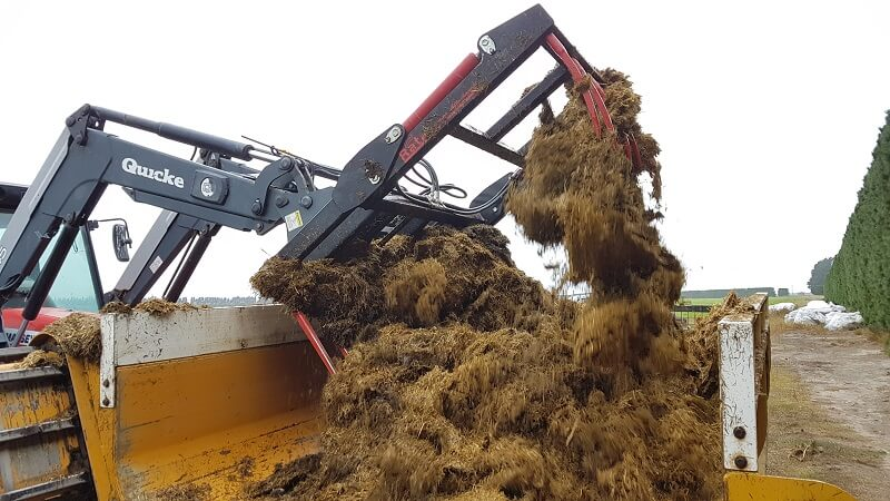 Rata Silage Grab unloading grass silage into feed out wagon
