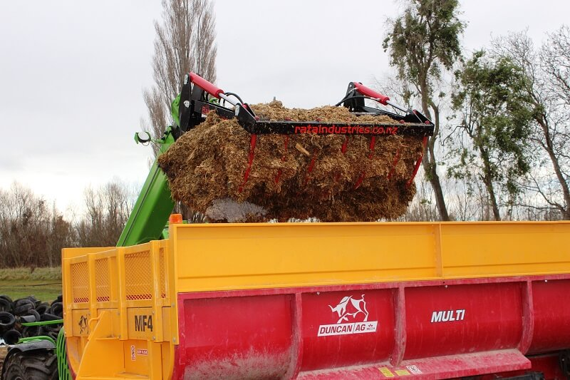 Rata Silage Grab on Merlo Telehandler loading feed out wagon