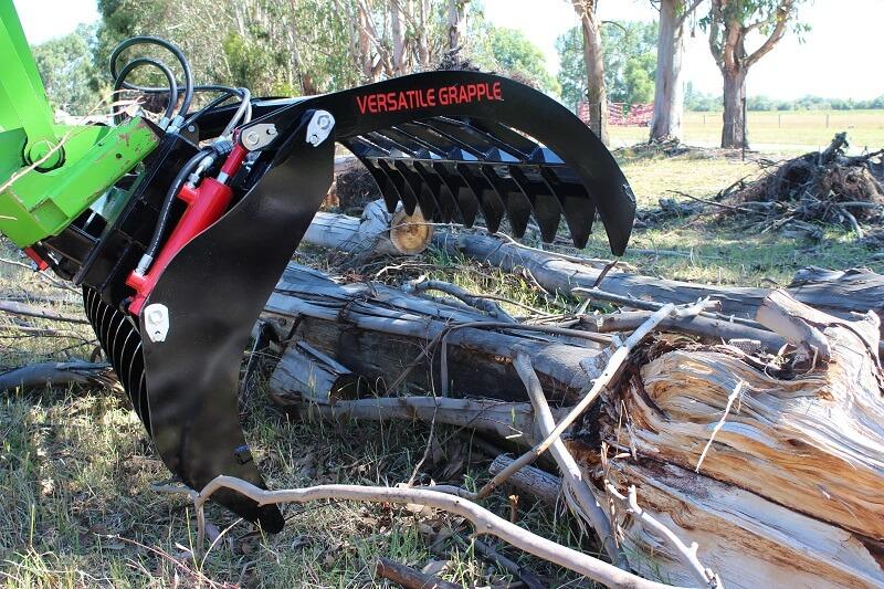 Versatile Grapple on Merlo Telehandler picking up logs
