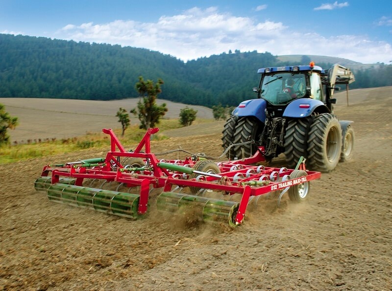 Rata 812 Trailing Maxitill behind New Holland Tractor
