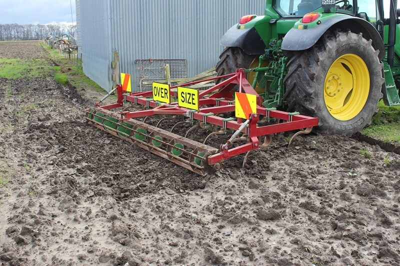 Rata Grubber in a muddy paddock on John Deere Tractor
