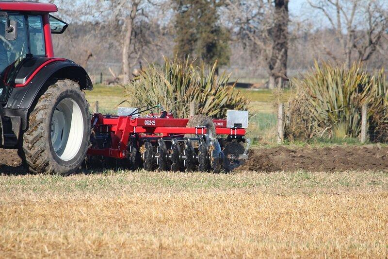 Rata Offset Plough Discs behind Valtra tractor
