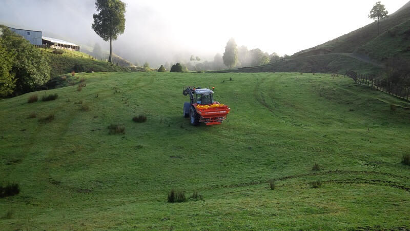 Agrex Kylo bulk fertiliser spreader working on a hill side