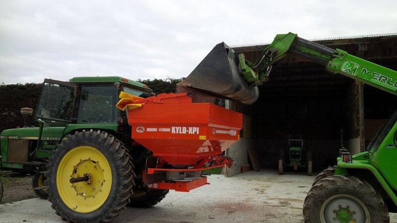 KYLO fertiliser spreader being loaded with a bucket