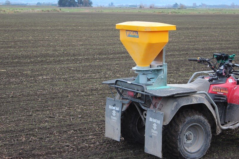 Vogal slug bait spreader mounted on atv ready to spread bait over a paddock
