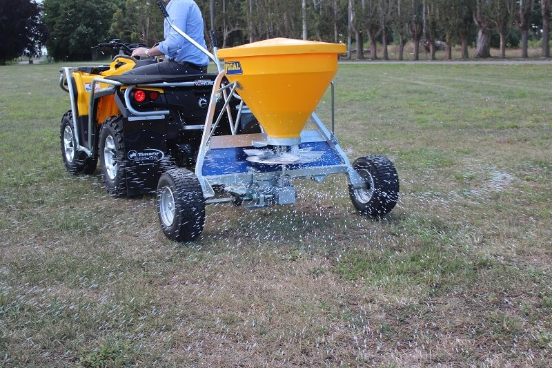 Spreading fertiliser behind quad bike with Vogal EX120 spreader - Rata Equipment - Rata Industries