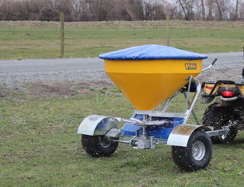 Vogal EX500 fertiliser spreading behind a quad bike in a paddock