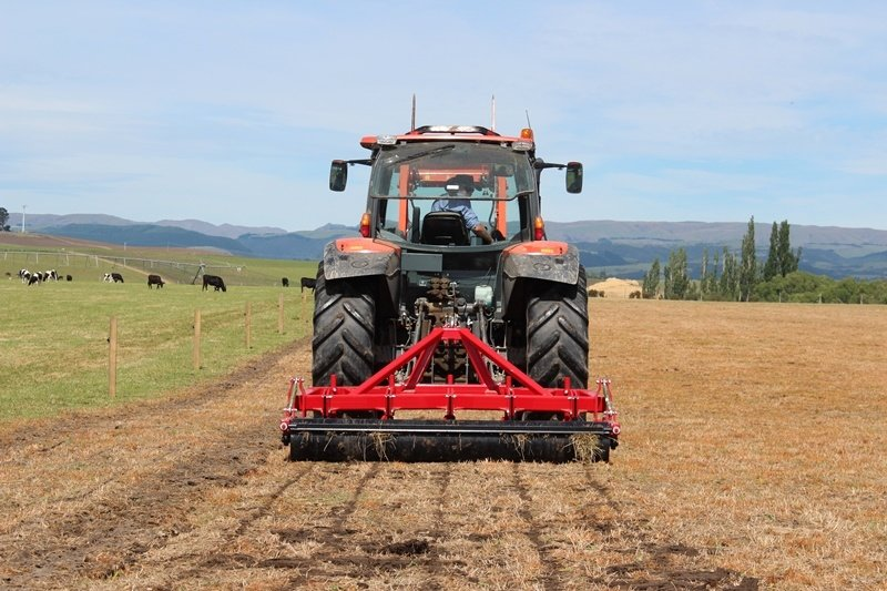 subsoil aerating a dry paddock suffering from soil compaction during a dry summer
