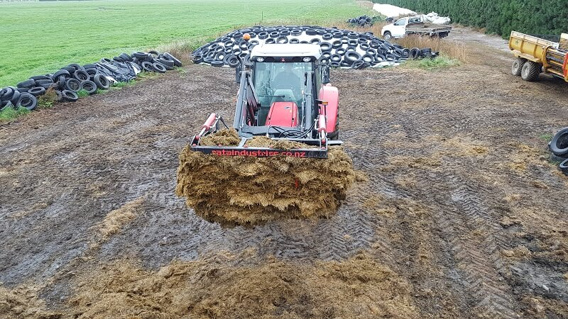 Rata Silage Grab holding stack silage on Massy Ferguson tractor